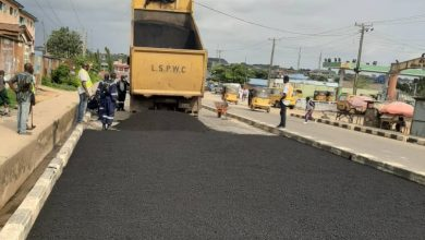 Photo of Maintenance work on Igando road by Igando Community High School now completed however, fixing of potholes on Igando road continues