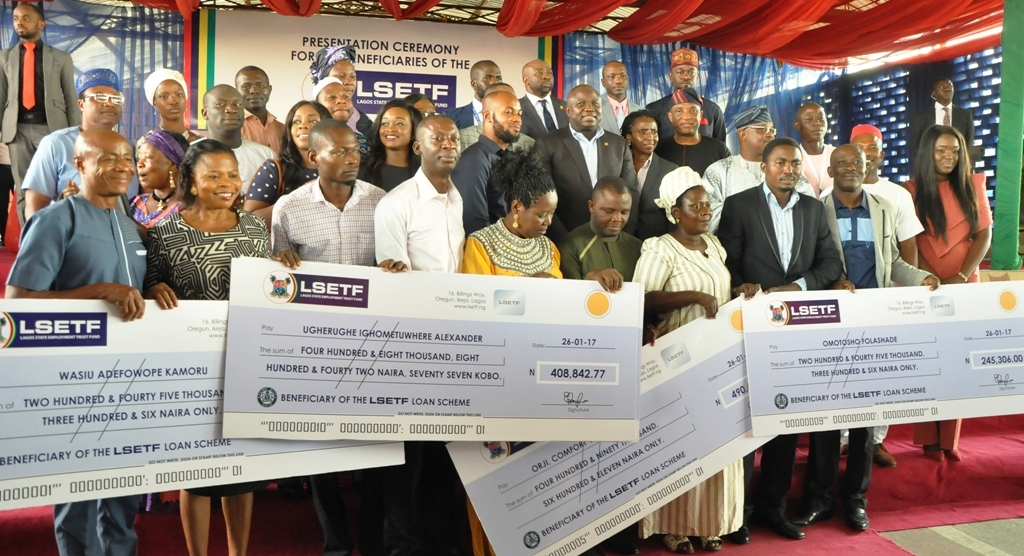 Photo of GOV. AMBODE AT LAGOS STATE EMPLOYMENT TRUST FUND CHEQUE PRESENTATION CEREMONY AT LTV BLUE ROOF, AGIDINGBI, IKEJA