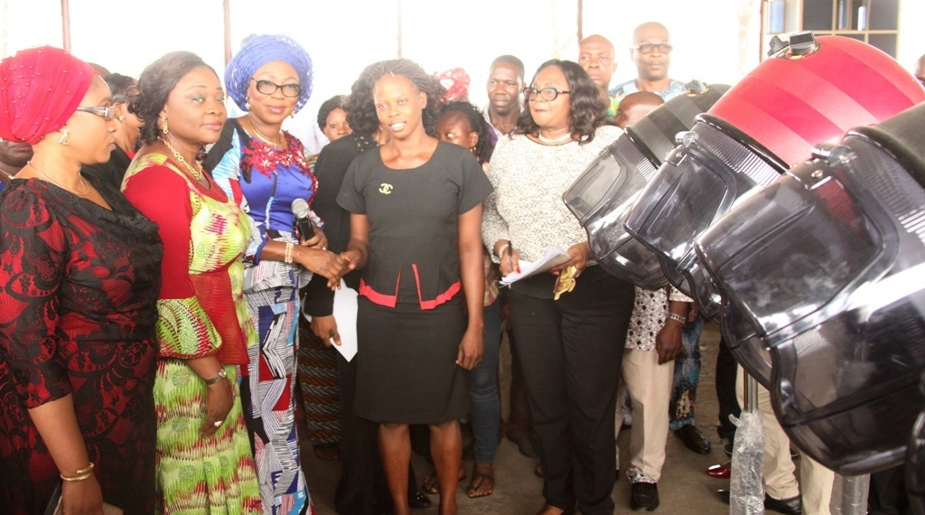 Photo of WIFE OF LAGOS STATE GOVERNOR, MRS. BOLANLE AMBODE, DEPUTY GOV. ADBEULE AT DISTRIBUTION OF VARIOUS EMPOWERMENT MATERIALS TO GRADUATES OF LAGOS STATE SKILL ACQUISITION CENTRES, WIDOWS, OTHERS