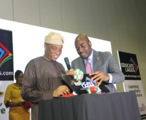 The Representative of the Governor and Secretary to the State Government, Mr. Tunji Bello logging in to the website. www.educate lagos.com to formally launch the Lagos State Digital Library while being assisted by the Special Adviser on Education, Mr. Obafela Bank- Olemoh at the formal unveiling of the Lagos Digital Library held at Landmark Events Centre, Oniru Estate on Friday, April 28, 2017.