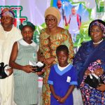 Wife of Lagos State Governor, Mrs. Bolanle Ambode (middle), with Deputy Governor, Dr. (Mrs.) Oluranti Adebule (right) and Chairman, House Committee on Education, Hon. Olarenwaju Ogunyemi (left), presenting shoes and socks to pupils of State Primary Schools in Lagos during the launching of Project Bright Steps, a Children Empowerment Project by Wife of the Governor & Founder of HOFOWEM at the Event Centre, Agidingbi, Ikeja