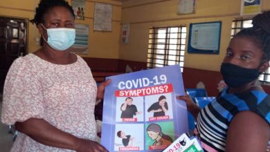 Photo of The distribution of COVID-19 posters at Itaelewa Primary Health Centre and Lagos Neighbourhood Safety Corps station in Ikorodu, by a member of the COVID-19 enlightenment campaign team of the Lagos State Ministry of Information and Strategy Divisional Office in Ikorodu, during the ongoing sensitisation on the emergence of a second wave of the virus.